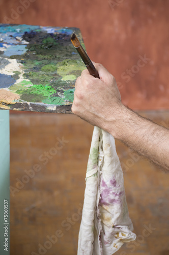 canvas print picture painters hand with brush and rag