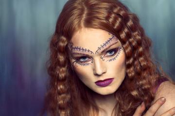 Beautiful woman in creative makeup