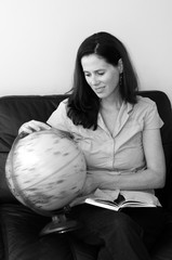 Woman Search and Examining the Globe