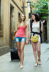 Two young women with luggage