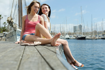 Two  young women sitting on the berth