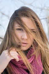 Beautiful young blonde woman with pink scarf. No retouch