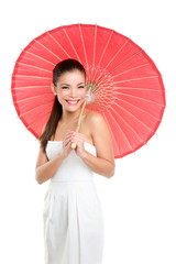 Chinese wedding woman with red paper umbrella