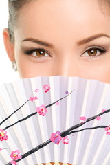 Eyes makeup asian look with paper fan