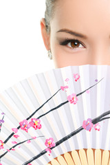 Asian chinese woman looking seductive with paper fan
