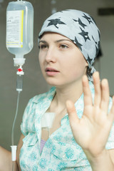 Cancer girl with scarf in hospital