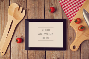 Tablet mock up template with cooking utensil. View from above