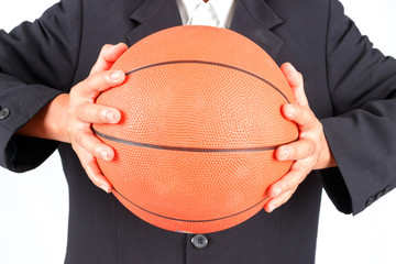 Business man holding a basketball isolated on white background