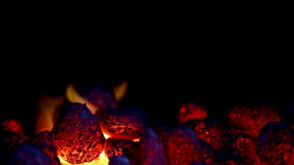 closeup of glowing coal with some flames