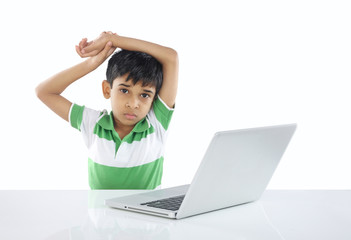Depressed Indian School Boy with Laptop