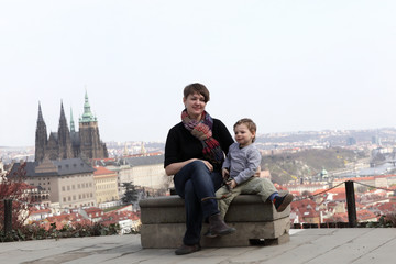 Family posing on St. Vitus Cathedral background