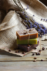 Handmade soap on wooden boards with coffee beans