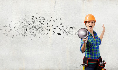 Construction worker announcing something