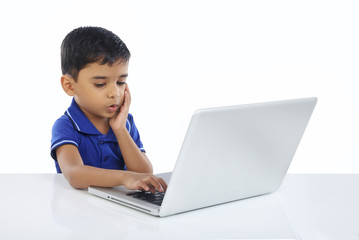 Indian Little Boy With Laptop
