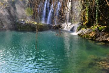 Green lake and waterfall