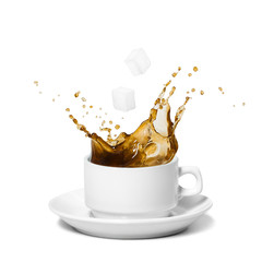 Coffee splash. Sugar cubes being dropped into coffee. Isolated