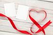 Obrazy na płótnie, fototapety, zdjęcia, fotoobrazy drukowane : Photo frame cards with valentines heart shaped ribbon