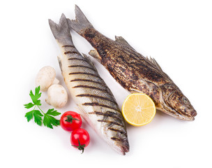 Two grilled seabass fish.