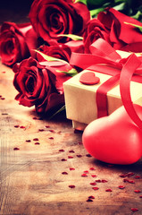 Valentine's setting with red roses and present