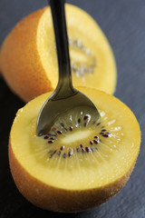 Kiwi gold fruit with a spoon