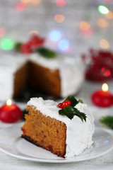 Slice of cake covered cream with Christmas decoration
