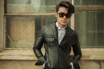 Fashion man posing near old building