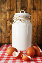 Milk can with eggs and eggshell