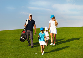Family of golf players at the course