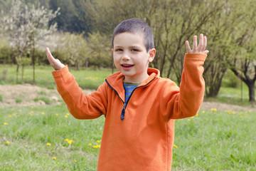 Happy child in spring garden