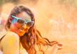 Leinwandbild Motiv Happy young girl on holi color festival