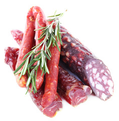Assortment of smoked sausages isolated on white