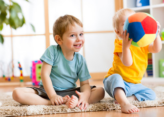 children play with ball indoor