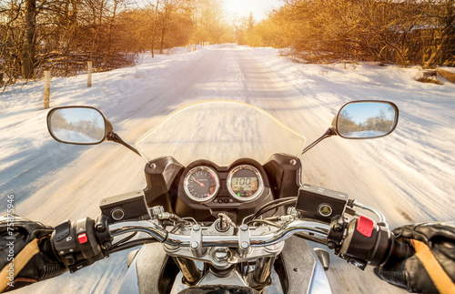 Biker First-person view. Winter slippery road - 75875946