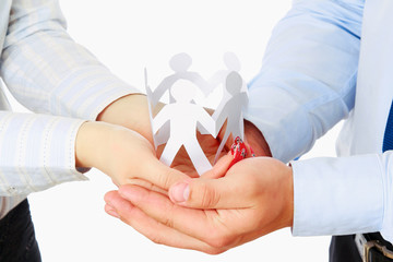 Business couple with paper people isolated. Focus on hands