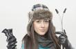 female skier. holds ski sticks.