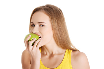 Portrait of a woman eating an apple