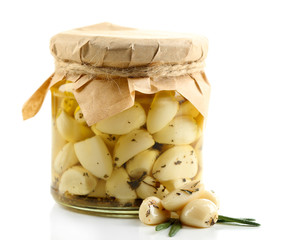 Canned garlic in glass jar, isolated on white