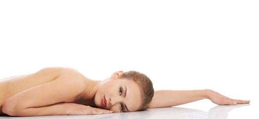 Sexy fit naked woman lying on belly