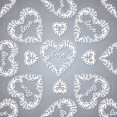Seamless background with lacy hearts and lettering.