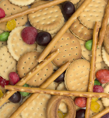 Biscuits with round colored candies. Photo. Background.