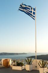 Greek flag raised at Santorini island in Cyclades