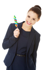 Young businesswoman holding a lolipop