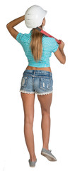 Beautiful girl in white helmet, shorts and shirt holding builder