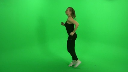 Girl run on green screen, listening music