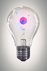 lamp bulb and nuclear atom model on grey background