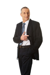 Mature businessman pointing to the right