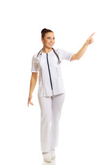 Female doctor pointing to the right