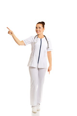 Female doctor pointing to the left