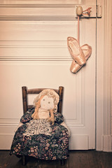 Old rag doll and pointe dance shoes, vintage process