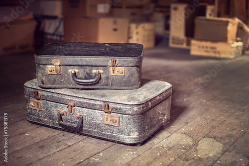 canvas print picture Old vintage suitcases in a dusty attic